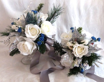 Silver white and blue winter wedding bouquet and boutonniere roses silver glitter pine, green pine, and crystal gems