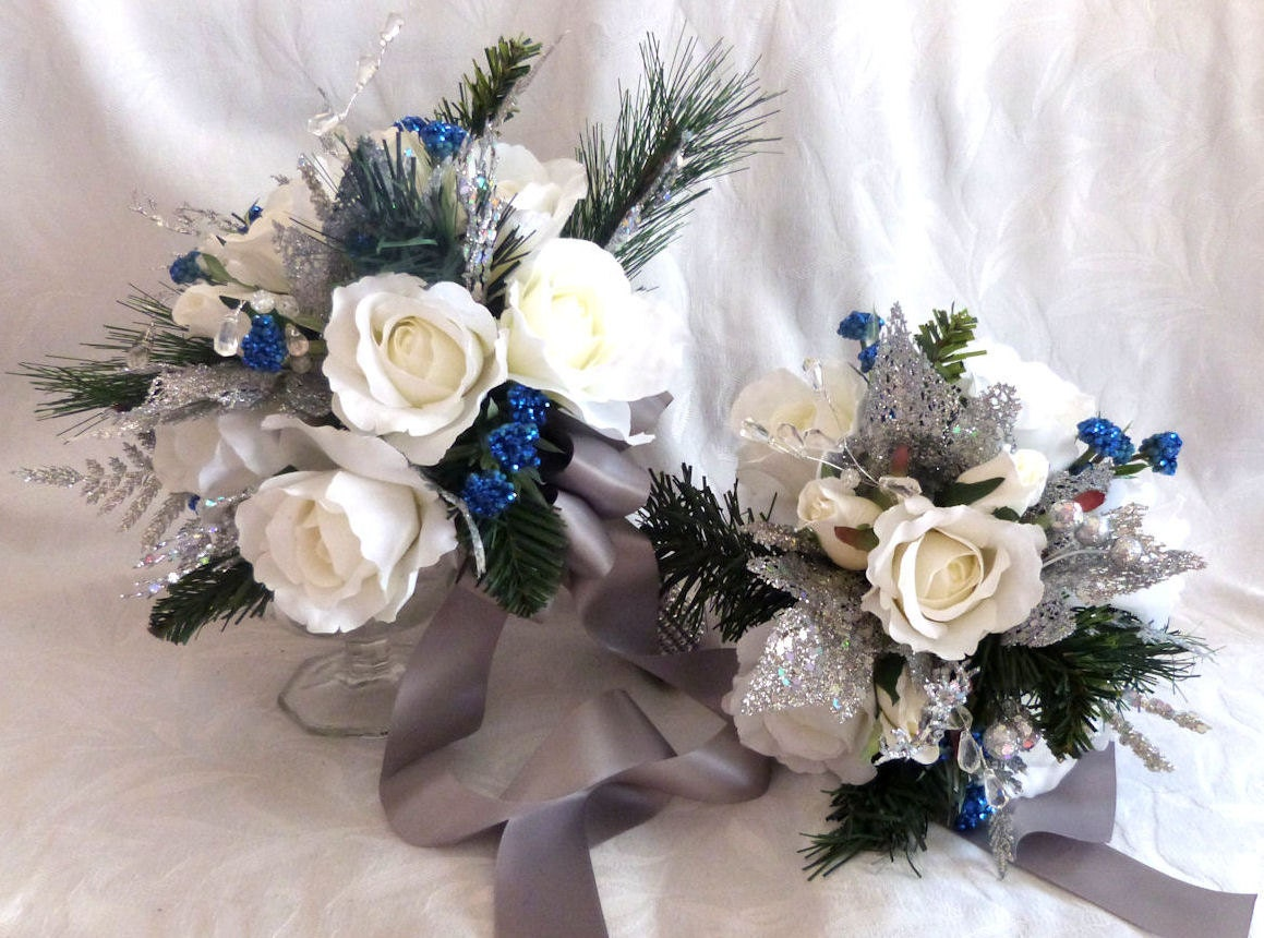 Silver white and blue winter wedding bouquet and boutonniere