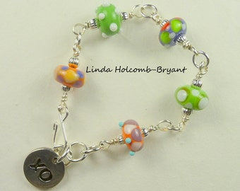 Bracelet of Green, Orange, White, Purple and Red Lampwork Beads