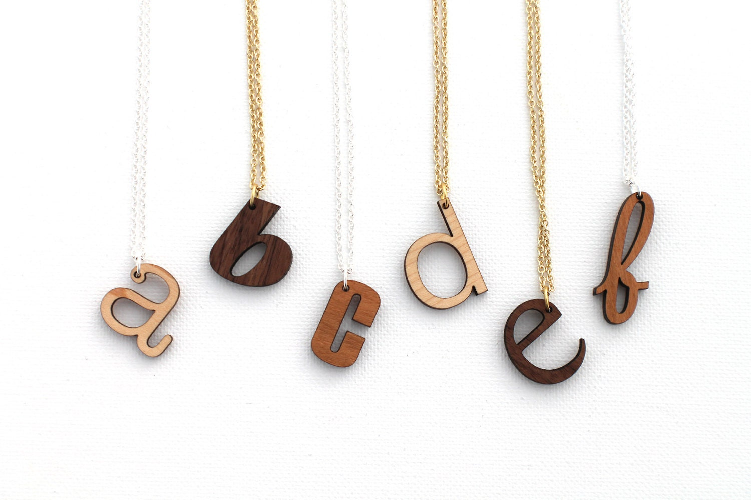 custom initial necklace laser cut wooden by havokdesigns