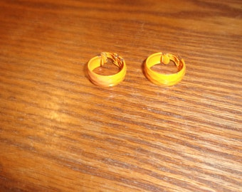 vintage clip on earrings orange metal hoops