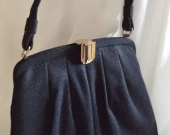Vintage Black Wool Flat Bottom Handbag with Gold Tone Clasp and Satin Lining