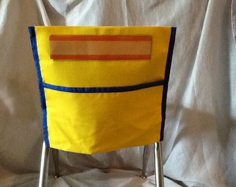Bright Yellow trimmed chair pocket with name tag! Our chair pockets are also trimmed in complimentary colors.