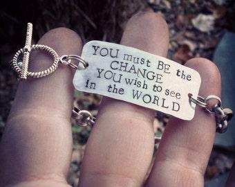 "hand-stamped ""be the change"" dog tag bracelet"