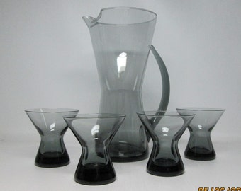 MORGANTOWN smoke gray glass cocktail pitcher with four hourglass shaped glasses mid-century