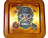 Day of the Dead Art! This Sugar Skull Clock is the best way to celebrate Dia De Los Muertos. Especially with tooled leather sugar skull art