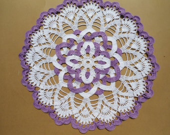 White and purple crochet doily