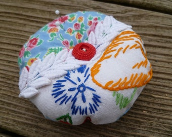 Pincushion, vintage embroidery and buttons