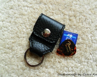 100% hand stitched handmade black cowhide leather keychain / SD card / guitar pick / golf ball marker holder with a Fender Celluloid pick