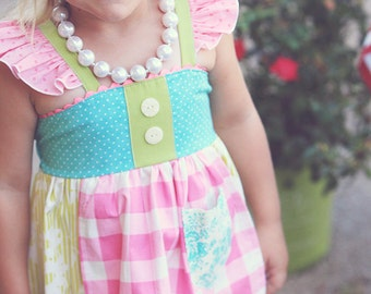 Garden Girl Reverse Knot Dress with Ruffle and Apron Accents