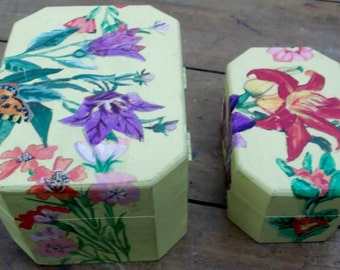 Pair of yellow jewellery boxes with hand painted flowers