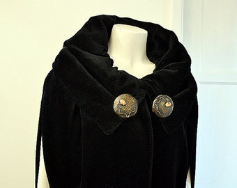dramatic black opera cape with arts and crafts clasp 1920s vintage