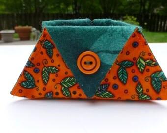 orange and green thread catcher