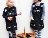 Black cat dress up costume.