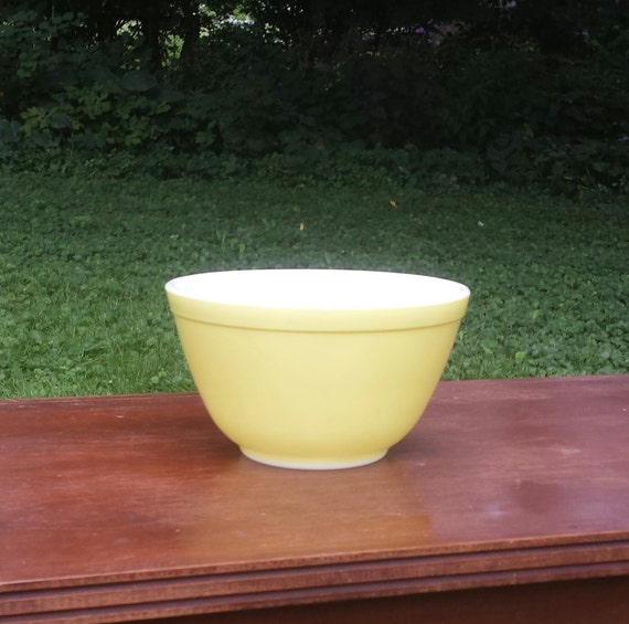 vintage small pale yellow pyrex nesting bowl by offbeetvintage