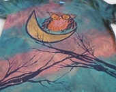 Woman's large discharge t-shirt with an adorable owl sitting on the moon, bare branches on both sides, turquoise, pink, orange, yellow