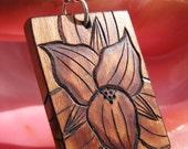 "Trillium Blossom on Cherry Wood Pyrography Woodburning Pendant 1.5""x1"""