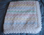 hand knitted baby's blanket in white and pink,lemon ,blue, green