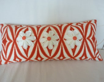 Orange/red lumbar pillow cover with hand-folded flowers