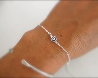 Blue evil eye bracelet on sterling silver chain