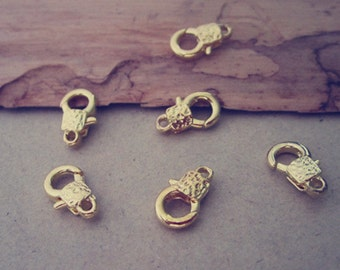 12pcs gold color Lobster Clasps with pattern 7mmx12mm