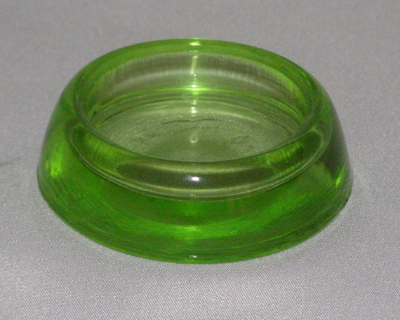 vintage green glass furniture protector outside 1