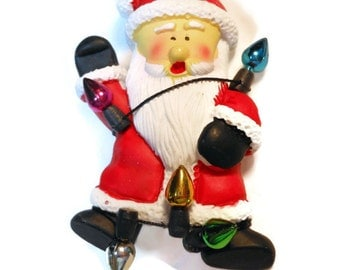 Santa Claus wrapped in lights brooch