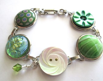 Green vintage button bracelet. Glass & shell buttons, silver links