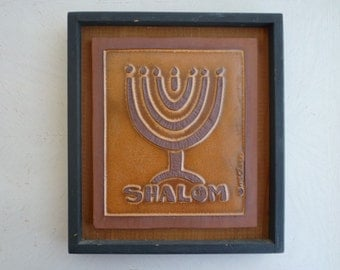Vintage Judaica hand-made framed Shalom and Seven arm Menorah tile wall hanging, signed Clare, dated 1976