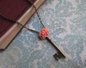 Unlocked Collection: Vintage-Style Skeleton Key Charm Necklace, Pink Rose Flower Decoration, Antique Bronze Tone, Longer Length.