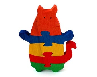 Toy Puzzle Funny CAT. Handmade wooden kids puzzle game that develops motor skills.