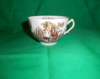 One (1), Flat Tea Cup, from Johnson Bros., in the Old Mill-Brown-Multi-Color Pattern.