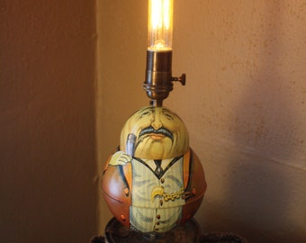 One of a kind roly poly vintage tobacco character tin accent lamp.