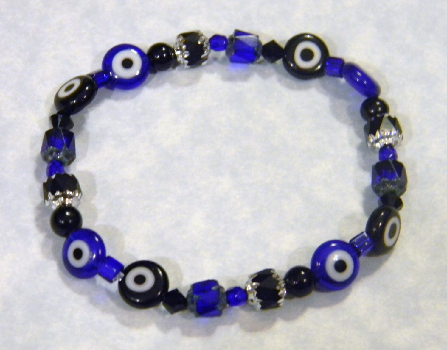black and cobalt blue evil eye and cathedral bead stretch
