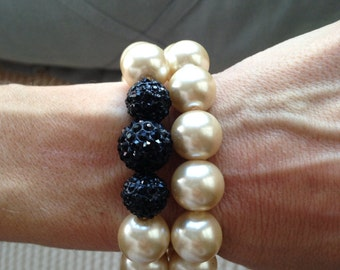 Large pearl beaded bracelet set with black pave crystal beads.