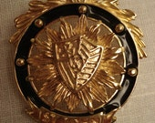 St. John  Gold and Black Shield Brooch with Pendants