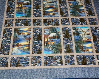 Winter scenery in a sparkley lap or throw quilt.
