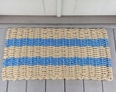 Tan and blue handwoven doormat from lobster trap rope.