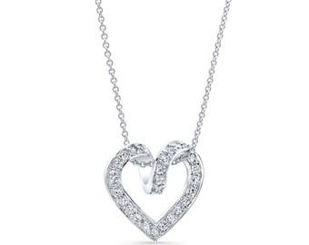 "Platinum Heart pendant 0.60 ctw G color VS2 clarity diamonds with 16"" white gold chain"