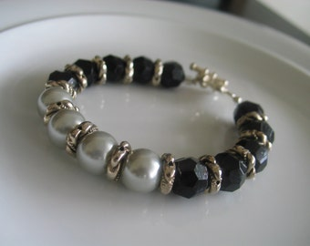 Black multifaceted beaded, silver toned links and gray pearl bead bracelet with flower toggle silver toned attachment, birthday gift