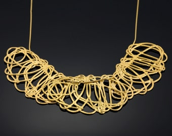 Gold statement necklace from the kishkush collection  .