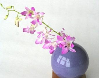 purple ceramic vase with solid cherry base