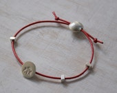Silver Pebble and Red Leather Bracelet