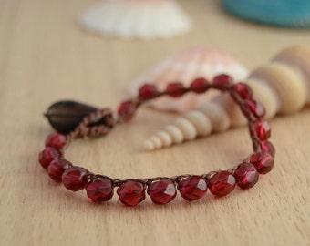 Red beaded crochet bracelet. Raspberry on brown nylon thread. Beach boho glam