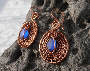 Antiqued copper wire wrapped earrings with blue sea glass