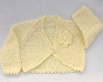 Baby sweater. Baby girl hand knitted cream baby bolero cardigan to fit 0 to 3 months