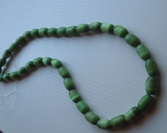 Strand of Green Oval Cats Eye Beads, apprx 10x5 mm