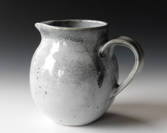 gray cream pitcher
