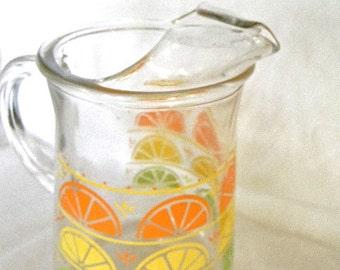 vintage glass pitcher in lemon and orange slice style