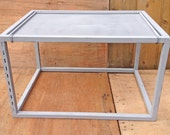 industrial looking grey metal coffee table.